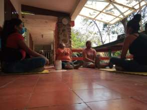 Family Mothers in Relaxing Yoga Session