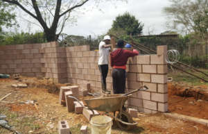 Sphe, one of our senior boys, helping the builder.