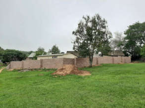 The village seen behind the new security wall.