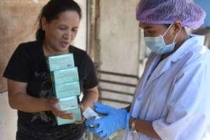 Nurse Shery providing pills to a govt partner