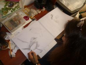 Photo1 - Juanita showing her drawings