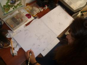 Photo2 - Juanita showing her drawings