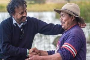 Felipe sharing with a local fisherman at Lake Tota
