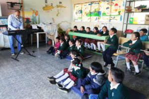 Calixto sharing to children first music lesson