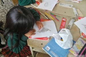 Children at Lake Tota, drawing the Apolinar's Wren