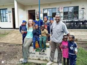 Returning volunteer with scholarship students