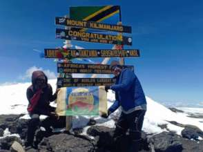 Jerry and Ikirwa flag on top of Uhuru peak