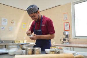 Fernando preparing the granola mix