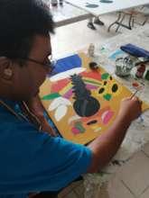 Daniel loves painting!