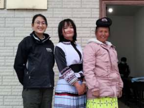 Meili (center) with her mother and Jenny Chu