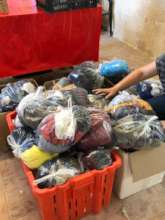 Clothes packs prepared for new arrivals on Lesvos