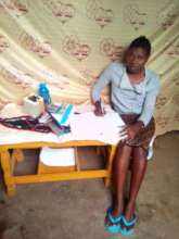 Olive uses her solar lamp and kindle to study.