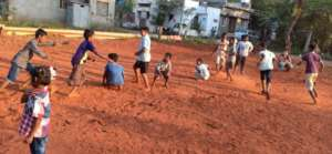 Children playing in the sports ground