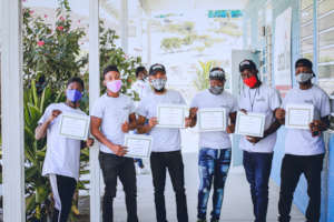 Welding graduates with their certificate