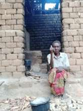 Woman  showing her kitchen.
