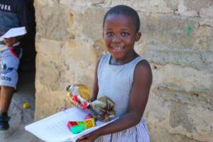 Andiswa with her Learnign at Home Pack & invention