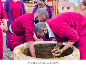 Students making biogas.