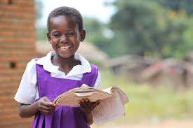 A girl reading on impact of Early marriage .