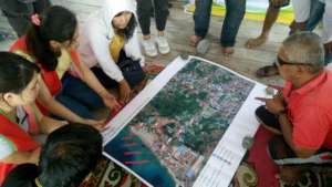 Discussing disaster map with local residents