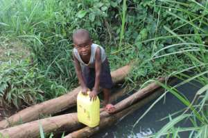 a kid at a dirty well