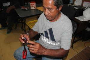 Chief Kelak (Dehpek/Takaiou Community) with camera