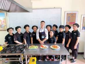 Chef training with a restaurant's kitchen manager