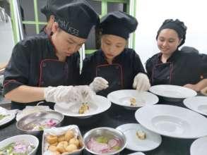 Trainees preparing a dish