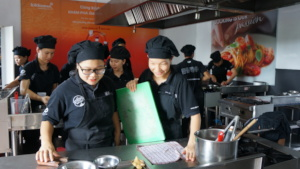 Females trainees in the kitchen
