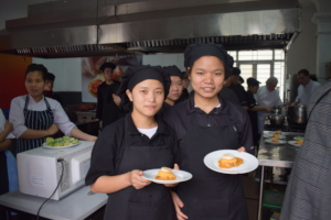 Female trainees completing their culinary cooking