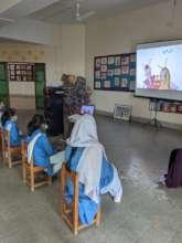 Primary school students watching a Tiflatoon story