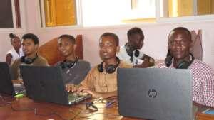 Boys use Elimu laptops to pursue Cisco courses.