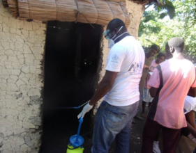 The team disinfecting a home to stop cholera