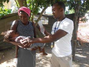 Providing cholera treatment to an infant