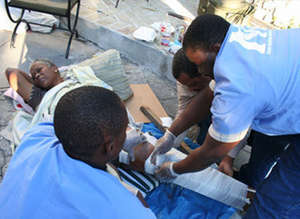 IMC staff providing medical care