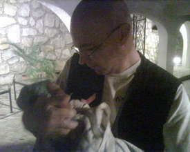 Dr. Liviu Vedrasco holds a tiny patient