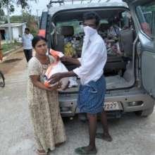 BASS staff distributing essential food kits
