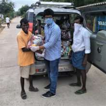 Project leader distributing the relief