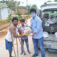 Project leader distributing relief to a family
