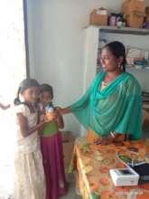 BASS distributing immunity capsules to children