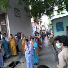 Row of the people to get relief in a slum
