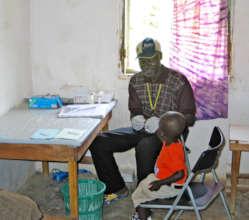 Seeing a patient at Kolahun Hospital