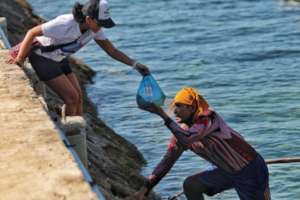 Fishing community collecting food-packs