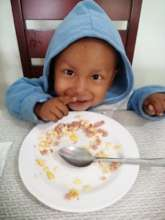 Two year old Alex smiling after his yummy lunch
