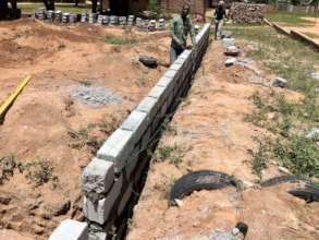 A mason laying blocks