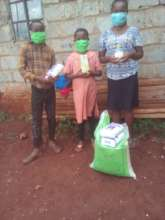Emma & her siblings with their emergency supplies