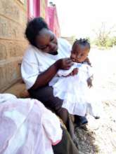 Judy and her baby, supported by our emergency fund