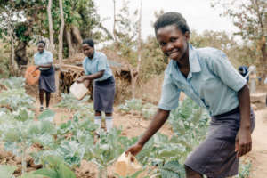 Student waters the crops at Kitui Seed of Hope