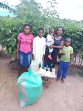 Rose and her family with emergency food supplies