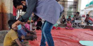 A LEEDO outreach worker distributing supplies