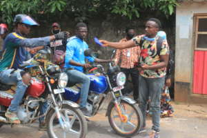 Distributing masks to okadas - bike riders